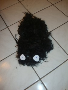 Big heap of hair on the floor with two paper eyes